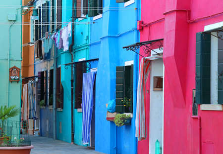 Colorful houses on the island of Burano near Venice in Italy in summer Stock Photo - 78564113