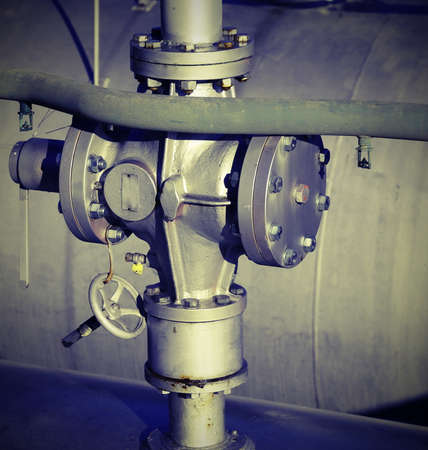 old valve for the closure of the distribution of methane gas in the big industrial refinery with lomo effect Imagens