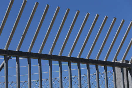 delineate: Robust steel barriers to delineate the camp for migrant migrants