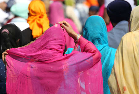 kameez: many Women with the veil over their heads during a religious event on the streets of the city