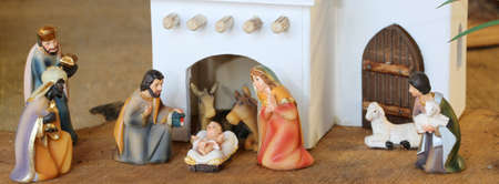 Palestinian nativity scene with holy family set in the middle east with a typical white house