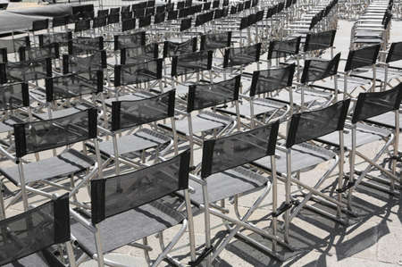 void: empty chairs before the live concert in the square of the city