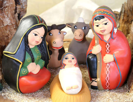 Peruvian holy family with South America dressed with ceramic and earthenware animals Stock Photo