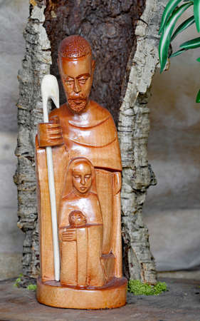 Nativity scene with the Holy Family carved out of wood in African style