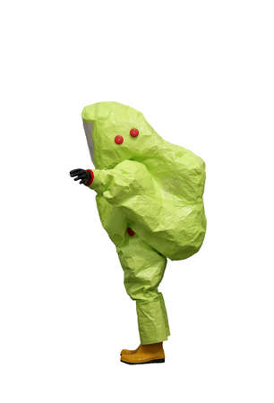 Person with yellow protective suit with air filtering system to breathe during a fire or during a bacteriological attack on white background Stock Photo