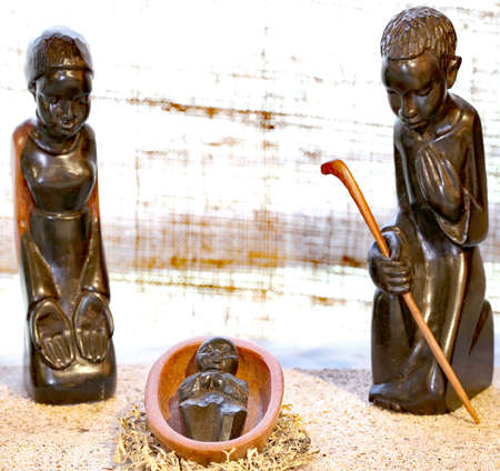 Nativity scene with the holy family carved on the wooden black from Tanzania in African style