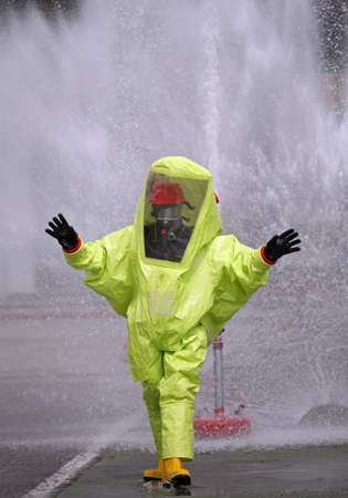 Man with a yellow protective suit against radiation and chemical agents and polluted air