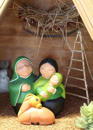 christmastide: Nativity scene with the holy family from Bolivia in South American style with a llama