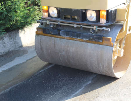 steamroller during the asphalt laying on the road construction site