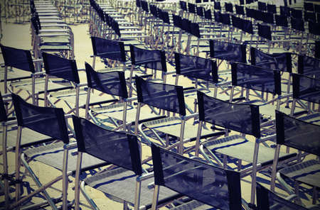 lodgings: many empty chairs before the event with vintage effect Stock Photo