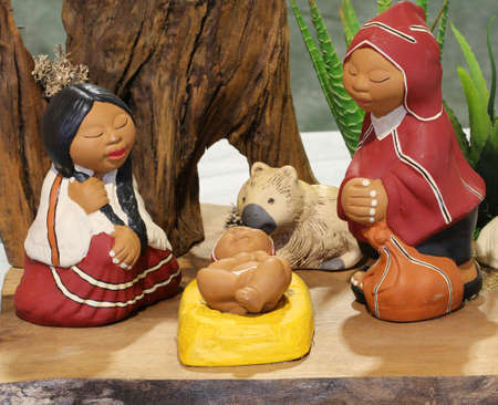 Nativity scene with the holy family from Bolivia in South American style with a llama