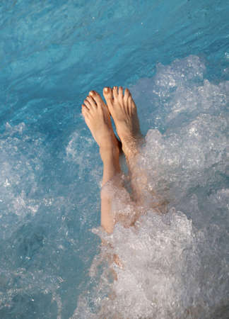 Woman bumps into the spa pool during a therapeutic hydromassage session
