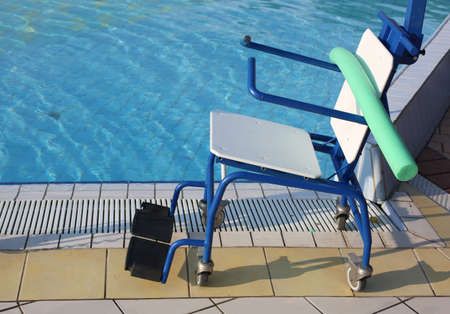 Matellaic Special wheelchair to enter the pool for rehabilitative gymnastics of traumatized people Stock Photo