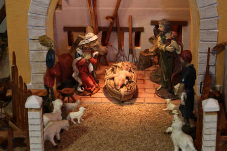 nativity scene with holy family in a stall with old farm tools