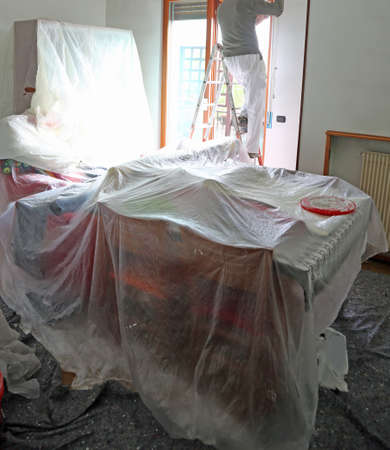 painting: living room of the house during painting of the walls