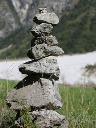 pile of stones to symbolize a prayer in the mountains Stock Photo