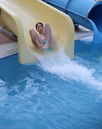 intrepid child plays on the yellow slide pool