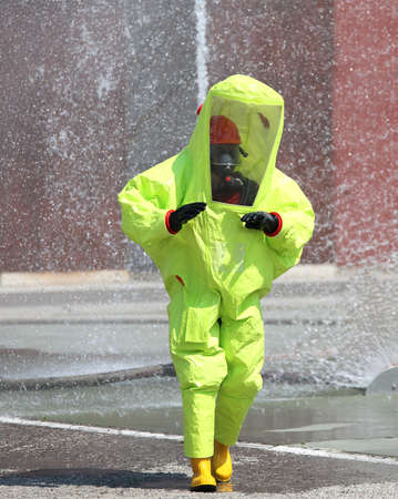 Man with a Yellow protective suit against chemical and bacteriological agents