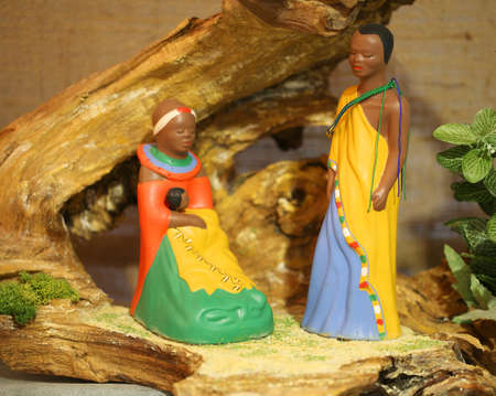 Kenya nativity scene with wooden statues with colored African clothes