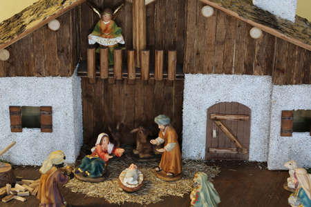 nativity scene with the holy family and an angel with the message GLORIA that means GLORY in Italian