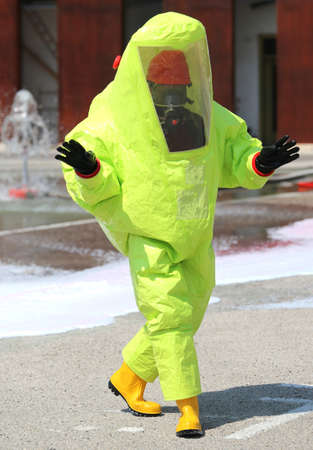 Person with a protective suit against chemical and bacteriological agents during an outdoor exercise