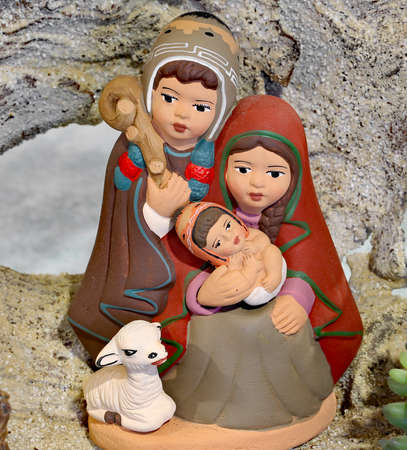 Peruvian nativity scene with the Holy Family and the little baby Jesus made with painted pottery Stock Photo