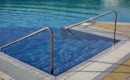 Ladder with steel handrail to access the pool for muscle rehabilitation at a spa