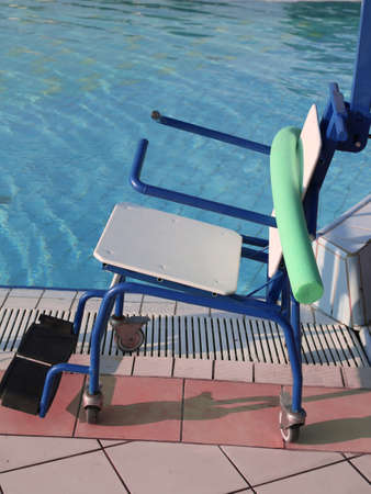 Special wheelchair to enter the swimming pool for rehabilitative gymnastics at an exclusive health center