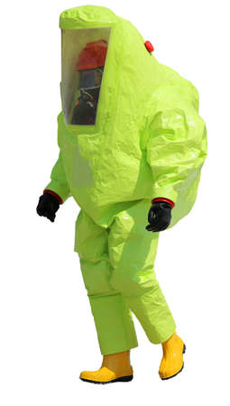 Firefighter with protective suit against chemical and bacteriological agents during an outdoor exercise on white background