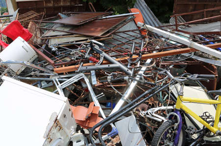 background of dump of ferrous material with many rusty and unusable objects