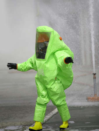 Green protective suit with air filtering system to breathe during a fire or during a bacteriological attack