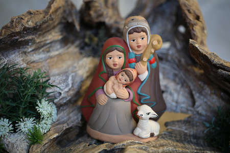 peruvian family with white sheep with winter clothes in Latin American Style  which symbolizes the Holy Family of Baby Jesus At Christmas