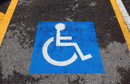 reserved parking car with wheelchair symbol on blue background Stock Photo - 81937400