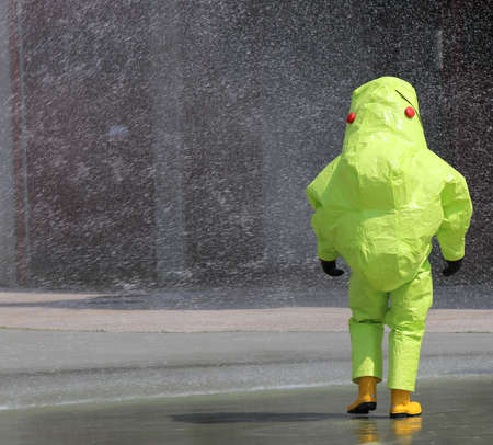 person with protective clothing against chemical and biological agents during an outdoor exercise Stock Photo