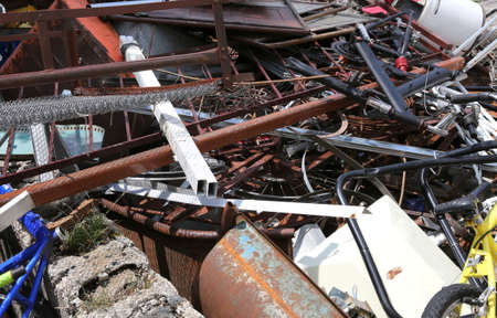 rusted objects in a dump in recycler that recovers ferrous material