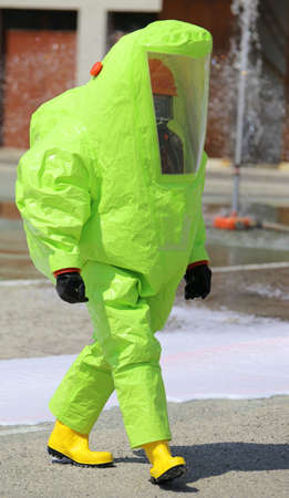 person with yellow protective clothing against chemical agents