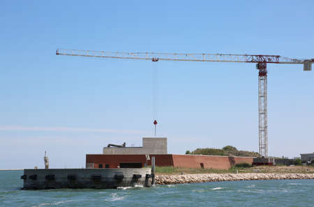 Big building called Mose is a project to protect Venice in Italy and other islands from flooding