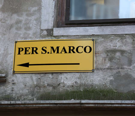 venice: Big signpost with directions to go to St. Marks Square in Venice in Italy Editorial