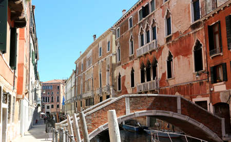 View of the old houses of Venice in Italy and a brick bridge