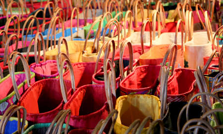 Lots of handbags for women with leather handles for sale on the market stand Stock Photo