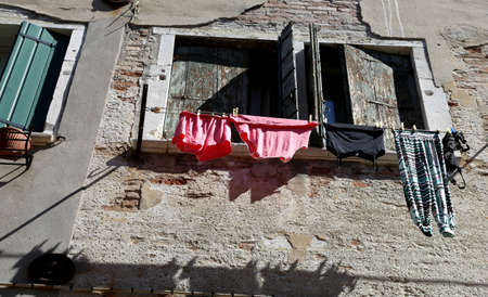 Underwear and cloths to dry out of the house in Italy