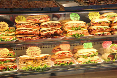 Lots sandwiches stuffed for sale in the bar in italy with the price Stock Photo
