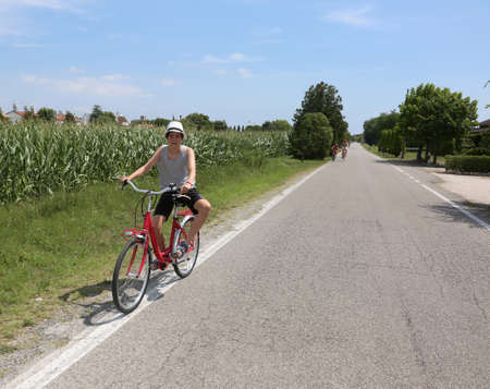 young cyclist riding bicycles on European roads