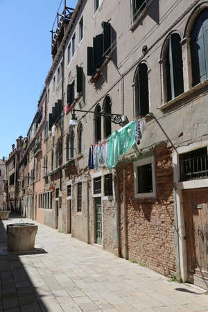 largest street called CALLA in Venice with the well and the clothes hanging