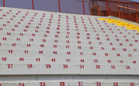 many numbers on the stadium bleachers to indicate a seat at sporting events Stock Photo