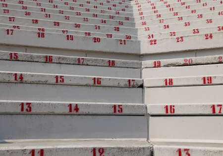 many numbers on the stadium bleachers to indicate a seat at sporting events Imagens