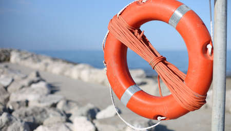 lifebuoy for people near rocks at the sea in summer