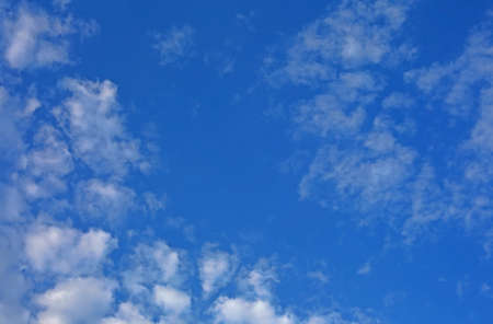 Simple and beautiful blue sky background with white clouds Stock Photo