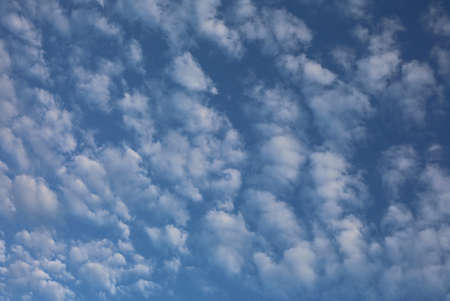 Background of white clouds and the blue sky of a dreary summer day Stock Photo