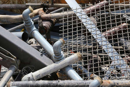 Ferrous material and old iron pipes in the landfill of recyclable material
